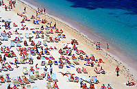 Bahamas, Nassau, Cable Beach. sunbathers on beach