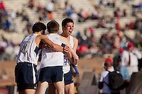 The La Salle College High School distance medley team celebrates after winning the Championship of America in that event, Friday, April 26, 2013 at the Penn Relays.