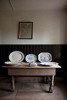 A well worn table in the scullery is now used to display a collection of meat plates from Tullynally's culinary past