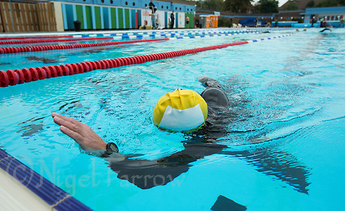 28 SEP 2013 - LONDON, GBR - Paul Gosney prepares to touch the wall at the end of another length of the pool during his 7.3 mile swim at Charlton Lido in London, Great Britain as part of the Enduroman 2013 Lands End to London to Dover ultra triathlon (PHOTO COPYRIGHT © 2013 NIGEL FARROW, ALL RIGHTS RESERVED)