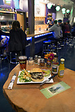 USA, Oregon, Ashland, truffle burger at the Caldera Brewery and Restaurant, the table is made from the same tree as the bar