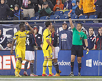 Second yellow, red card ejection for Waylon Francis. Foxborough, Massachusetts - October 4, 2014: In a Major League Soccer (MLS) match, the New England Revolution (blue/white) defeated Columbus Crew (yellow), 2-1, at Gillette Stadium.