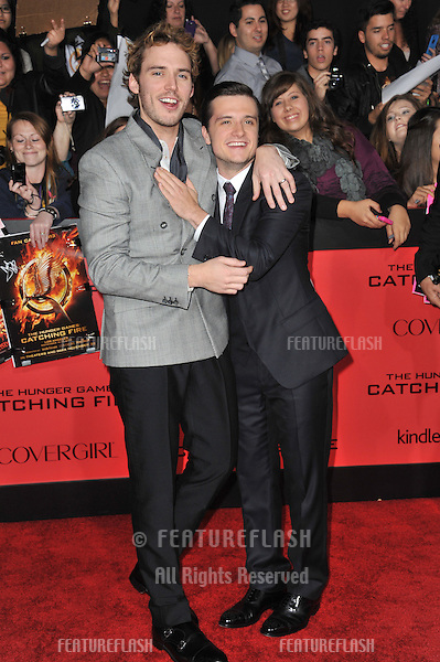 Sam Claflin (left) &amp; Josh Hutcherson at the US premiere of their movie &quot;The Hunger Games: Catching Fire&quot; at the Nokia Theatre LA Live.<br /> November 18, 2013  Los Angeles, CA<br /> Picture: Paul Smith / Featureflash