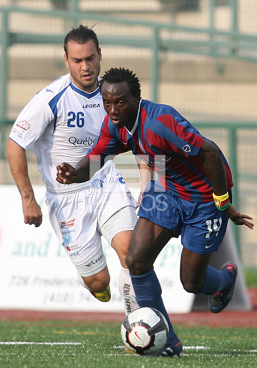 Mathew Mbuta #14 of Crystal Palace Baltimore breaks away from Antonio Ribeiro #26 of the Montreal Impact during an NASL match at Paul Angelo Russo Stadium in Towson, Maryland on August 21 2010. Montreal won 5-0.