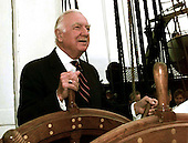 Marblehead, MA - (FILE) -- Retired CBS News anchor Mr. Walter Cronkite steers at the helm of the USS Constitution, the worlds oldest commissioned war ship, while underway in Massachusetts Bay, Massachusetts on July 21, 1997.  Commissioned on October 21st, 1797, Constitution set sail unassisted for the first time in 116 years.  Constitution will celebrates her 200th birthday on October 21st of this year after completing a 40 month overhaul.  Mr. Cronkite passed away on Friday, July 17, 2009..Mandatory Credit: Terry A. Cosgrove via CNP.