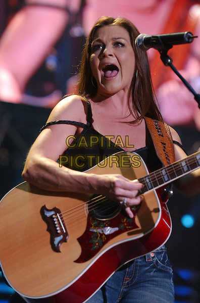 GRETCHEN WILSON.2007 CMA Music Festival held at LP Field,Nashville, Tennessee, USA, 10  June 2007..full length country concert performing live on stage guitar .CAP/ADM/LF.©Laura Farr/AdMedia/Capital Pictures.