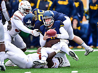 Morgantown, WV - NOV 18, 2017: Texas Longhorns defensive end Malcolm Roach (32) and Longhorns linebacker Gary Johnson (33) make a game changing play with a turnover sack against West Virginia Mountaineers quarterback Chris Chugunov (11) during game between West Virginia and Texas at Mountaineer Field at Milan Puskar Stadium Morgantown, West Virginia. (Photo by Phil Peters/Media Images International)