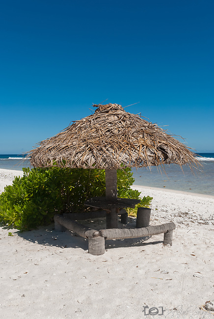 Thatched beach umbrellas providing shade in Kiritimati in Kiribati