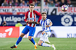 Antoine Griezmann (l) of Atletico de Madrid battles for the ball with Inigo Martinez Berridi of Real Sociedad during their La Liga match between Atletico de Madrid vs Real Sociedad at the Vicente Calderon Stadium on 04 April 2017 in Madrid, Spain. Photo by Diego Gonzalez Souto / Power Sport Images