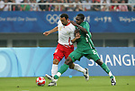 19 August 2008: Anthony Vanden Borre (BEL) (16) and Chibuzor Okonkwo (NGA) (2).  The men's Olympic soccer team of Nigeria defeated the men's Olympic soccer team of Belgium 4-1 at Shanghai Stadium in Shanghai, China in a Semifinal match in the Men's Olympic Football competition.