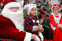 NWA Democrat-Gazette/DAVID GOTTSCHALK Angelina Lukien, 6, sits on the lap of Santa Claus Tuesday, December 4, 2018, after shopping  at the Walmart Supercenter on Pleasant Street in Springdale. More than 200 children participated in the Springdale Police Department Shop with a Cop program. The department collected $45,000 this year for the program.