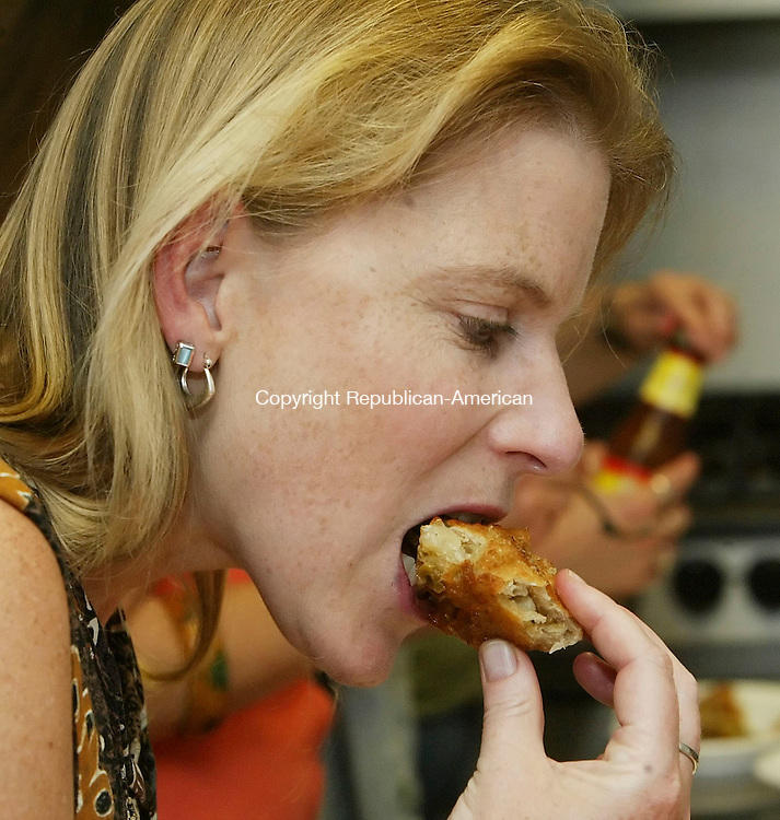 LITCHFIELD, CT, 29 June 2006- 062906BZ19- Pat Gaw, of Goshen, tries a Samosa during an Indian food cooking class led by Sadhna Qasba, of Torrington, at the Litchfield Community Center Thursday night.<br /> Jamison C. Bazinet Republican-American