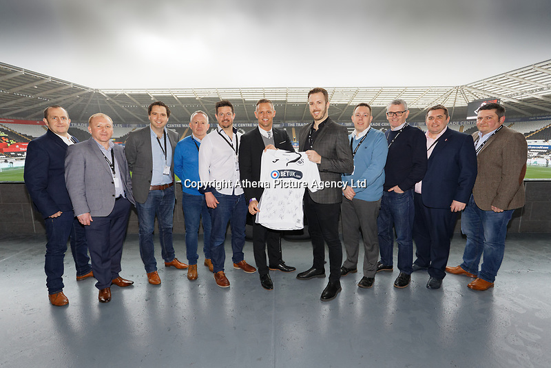 Lee Trundle with match sponsors during the English Emirates FA Cup soccer match between Swansea City and Manchester City at the Liberty Stadium, Swansea, Wales, Britain, 16 March 2019. EPA/DIMITRIS LEGAKIS <br /> EDITORIAL USE ONLY. No use with unauthorized audio, video, data, fixture lists, club/league logos or 'live' services. Online in-match use limited to 75 images, no video emulation. No use in betting, games or single club/league/player publications