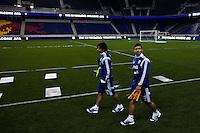Argentina striker Sergio Aguero (R ) and Ever Banega arrive to a practice at Red Bull stadium ahead of his friendly match against Ecuador in New Jersey, Nov 13, 2013. VIEWpress/Eduardo Munoz Alvarez