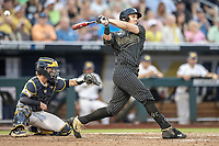 Vanderbilt Commodores outfielder JJ Bleday (51) follows through on his swing against the Michigan Wolverines during Game 2 of the NCAA College World Series Finals on June 25, 2019 at TD Ameritrade Park in Omaha, Nebraska. Vanderbilt defeated Michigan 4-1. (Andrew Woolley/Four Seam Images)
