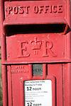 Close of detail red pillar Royal mail post box, UK