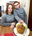 TORRINGTON, CT-122717JS03----Lori Pepler,  wife of late Torrington Fire Department Deputy Chief, Chris Pepler, and their son Nathan, 10, with Chris' helmet at their Torrington home Thursday. <br /> Jim Shannon Republican-American