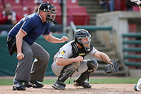 May 2, 2009: MWL Umpire Tyler Wilson and Chris Davis (11) of the South Bend Silver Hawks at Elfstrom Stadium in Geneva, IL.  Photo by: Chris Proctor/Four Seam Images
