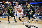 Wisconsin Badgers guard Josh Gasser (21) dribbles between Baylor Bears defenders Gary Franklin (4) and Isaiah Austion (21) during the fourth-round game in the NCAA college basketball tournament Thursday, March 27, 2014 in Anaheim, California. The Badgers won 69-52. (Photo by David Stluka)