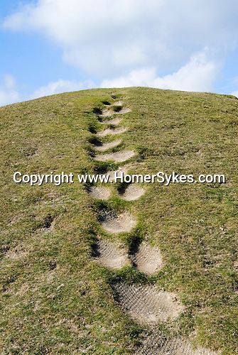 Figsbury Ring, Firsdown Wiltshire, UK. An Iron Age Hill Fort or a Neolthic Henge monument. Step,s in the ancient monument caused by excessive amount of people climbing over and around it.