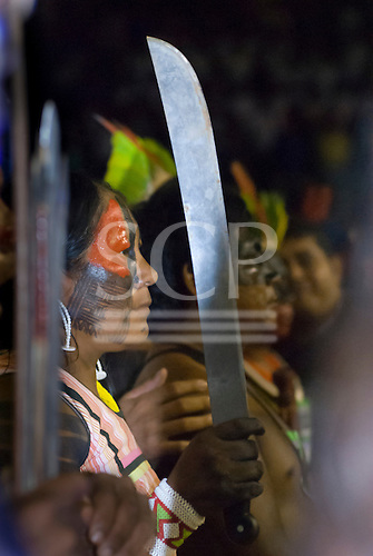 Altamira, Brazil. Encontro Xingu protest meeting about the proposed Belo Monte hydroeletric dam and other dams on the Xingu river and its tributaries. Tuira Kayapo with machete.