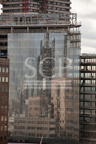 London, England. Reflection in a modern building under construction.