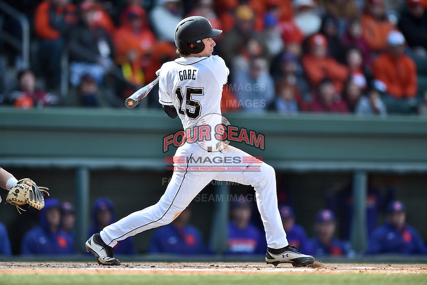 South Carolina third baseman Jordan Gore (15) swings at a pitch during a game against the Clemson Tigers at Fluor Field February 28, 2015 in Greenville, South Carolina. The Gamecocks defeated the Tigers 4-1. (Tony Farlow/Four Seam Images)