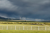 USA, Wyoming, Encampment, a white fenceline and open rolling landscape, Big Creek Ranch