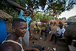 A man gets a haircut in a camp for internally displaced persons that formed around the Our Lady of Assumption Catholic Church in Riimenze, South Sudan. The parish has provided food, shelter material, and health care, and the presence of the local priest and a group of religious has contributed to a sense of relative safety.