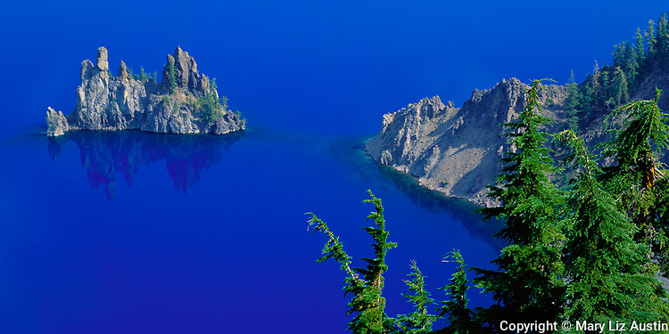 Crater Lake National Park, OR <br /> The Phantom Ship and its reflection in the blue waters of Crater Lake from Kerr Notch on the east rim
