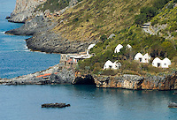 Italy, Calabria, Praia a Mare: popular resort at Riviera dei Cedri, huts at island Isola di Dino