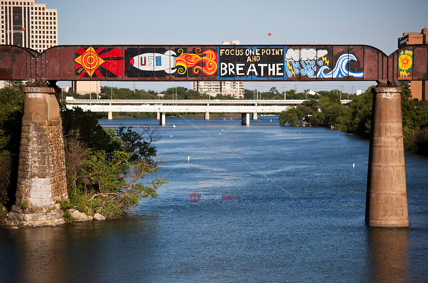 Union Pacific Railroad trestle over Lady Bird Lake adornes colorful graffiti