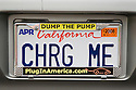 A 'GHRG ME' (Charge Me) electric vehicle license plate in 'Dump the Pump, Plug in America' frame. Plug In America company promotes electric and plug-in hybrid vehicles. Paolo Alto, California, USA