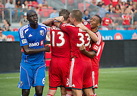 03 July 2013: Toronto FC celebrates a goal by Toronto FC defender Steven Caldwell #13 during an MLS game between the Montreal Impact and Toronto FC at BMO Field in Toronto, Ontario Canada.