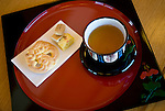 Photo shows a tray of jasmine tea and traditional Ryukyu confectionary served inside the Sasunoma, which is located inside the grounds of Shuri Castle in Naha, Okinawa Prefecture, Japan, on June 24, 2012. The Sasonuma once functioned as an anteroom for the Royal princes but today forms part of the tea room facilities serving jasmine tea and . Photographer: Robert Gilhooly