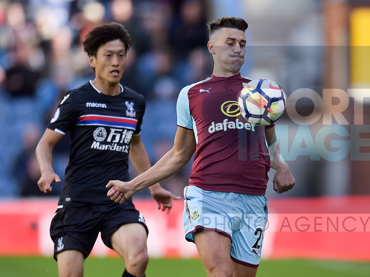 Burnley's Matthew Lowton and Crystal Palace's Lee Chung-Yong in action during the premier league match at the Turf Moor Stadium, Burnley. Picture date 10th September 2017. Picture credit should read: Paul Burrows/Sportimage