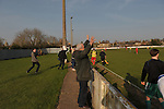 Stamford AFC 2 Marine 4, 29/03/2014. Wothorpe Road, Northern Premier League. Marine support celebrate the 4th goal during The Northern Premier League game between Stamford AFC and Marine from The Daniels Stadium. Marine won the game 4-2 in front of 320 supporters to boost their chances of relegation survival. Stamford AFC are moving to the brand new Zeeco Stadium at the end of the 2013/14 season Photo by Simon Gill.