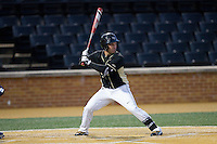 Joey Rodriguez (8) of the Wake Forest Demon Deacons at bat against the Delaware Blue Hens at Wake Forest Baseball Park on February 13, 2015 in Winston-Salem, North Carolina.  The Demon Deacons defeated the Blue Hens 3-2.  (Brian Westerholt/Four Seam Images)