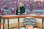 ESPN College Gameday reporter Erin Andrews reports live on the set at Camp Randall Stadium prior to the Wisconsin Badgers NCAA college football game against the Ohio State Buckeyes on October 16, 2010 at Camp Randall Stadium in Madison, Wisconsin.(Photo by David Stluka)