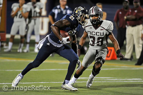 19 September 2015:  FIU wide receiver Thomas Owens (81) takes a reception 16 yards for a touchdown in the third quarter as the FIU Golden Panthers defeated the North Carolina Central University Eagles, 39-14, at FIU Stadium in Miami, Florida.