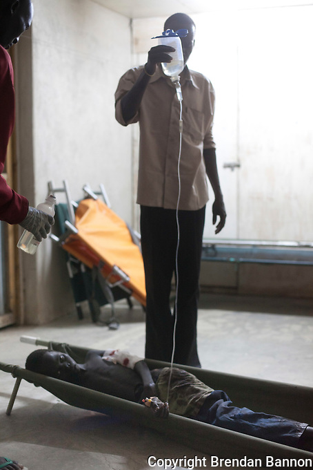 A 12 year old boy, accidentally shot in the arm, awaits surgery to repair  a fracture at the MSF hospital in Nasir, South Sudan.