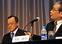 December 7, 2011, Tokyo, Japan - President Shuichi Takayama, left, of the scandal-hit Olympus Corp. listens as his accounting manager Nobuyuki Onishi speaks during a news conference at a Tokyo hotel on Wednesday, December 07, 2011, a day after an independent panel set up by the Japanese optical equipment company released the results of its investigation into the companys cover-up of investment losses. Takayama hinted at the news conference that the companys top brass may step down at the next shareholders meeting, most likely in February 2012 at the earliest. Former President Michael Woodford is calling for an extraordinary shareholders meeting to discuss the accounting scandal. (Photo by Natsuki Sakai/AFLO) [3615] -mis-
