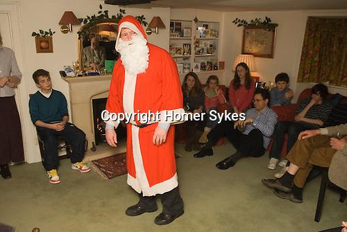 Father Christmas introducing traditional English Folk Play The Bampton Mummers performing Christmas Eve. Bampton Oxfordshire.   UK 2008.