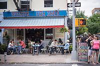 Sidewalk cafe in the trendy hipster Williamsburg neighborhood of Brooklyn in New York on Saturday, June 8, 2013. © Richard B. Levine)
