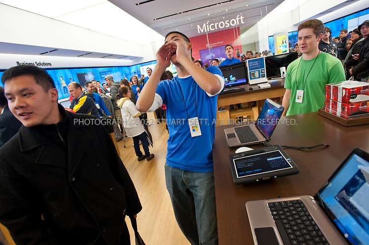 10/20/2011--Seattle, WA, USA..Microsoft store employee Jonathan Feng (center)cheers arriving customers in the new Microsoft store in Seattle, WASH., for the 9am opening...Microsoft (MSFT) opened their 12th retail store in Seattle's U-Village shopping center today. Nearly 1000 people waited in line for the opening of the company's first store in Seattle. The store opened up directly across from an Apple store. Nationwide, Microsoft will open two more this fall, in California and Virginia. ..©2011 Stuart Isett. All rights reserved.