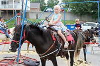 MEGAN DAVIS MCDONALD COUNTY PRESS/Quincy Morgan celebrated her 2018 Little Miss Strawberry pageant placing with a pony ride in Town Hole Park during the Berries, Bluegrass & BBQ Festival last year.
