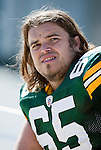 Green Bay Packers offensive lineman Mark Tauscher (65) looks on during an NFL football game against the Detroit Lions in Green Bay, Wisconsin on October 3, 2010. The Packers won 28-26. (AP Photo/David Stluka)