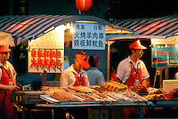Densely packed with restaurants and street food stalls, The Donghuamen Night Market is located to the northern end of the Wangfujing Street in Beijing. The food stalls serve a wide variety of exotic street food. Crickets, centipedes & scorpions, and silk worms are a few of the bazarre foods available to sample on a stick..