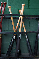 Baseball bats in the bat rack of the Kannapolis Intimidators prior to the game against the Charleston RiverDogs at CMC-NorthEast Stadium on June 28, 2014 in Kannapolis, North Carolina.  The Intimidators defeated the RiverDogs 4-3. (Brian Westerholt/Four Seam Images)