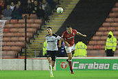 12th September 2017, Oakwell, Barnsley, England; Carabao Cup, second round, Barnsley versus Derby County; Matty Pearson of Barnsley FC heads the ball clear from Jason Shackell of Derby County